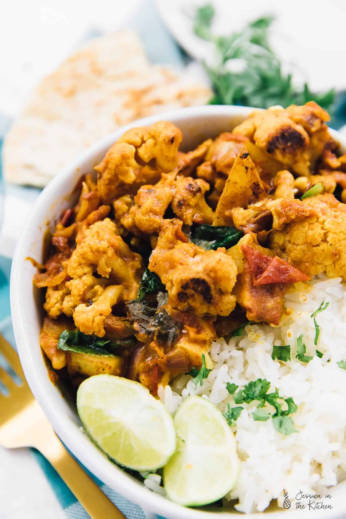 This Cauliflower and Potato Curry dish is perfect for a weeknight dinner! It's loaded with delicious spices and comes together so easily! via https://jessicainthekitchen.com