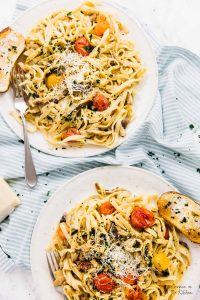 This Date Night Pasta comes together in less than 30 minutes and is loaded with flavour! It's made with burst tomatoes, sautéed shiitake mushrooms and garlic in a creamy, inviting pasta! via https://jessicainthekitchen.com