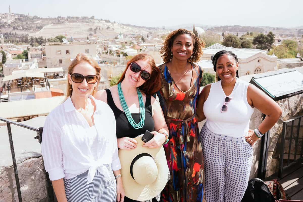 Jessica in Israel, with friends, posing for the camera.