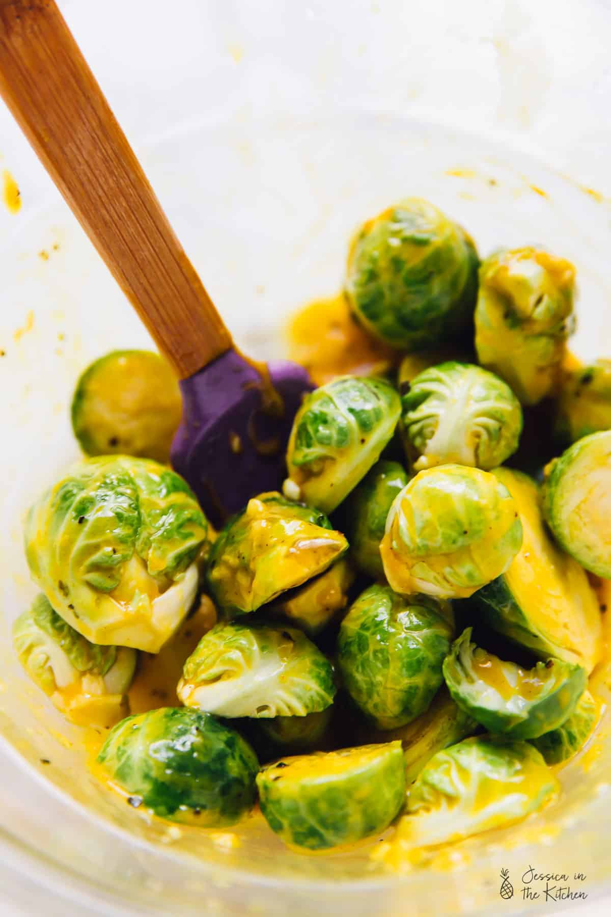 These mouthwatering Grilled Maple Mustard Brussels Sprouts will be your new favourite appetiser! Made quickly and easily on the grill, you'll be making extras! via https://jessicainthekitchen.com
