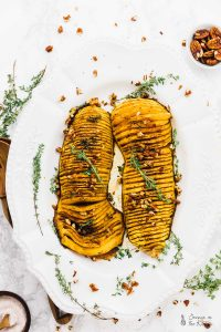 Tis' the season for this decadent and delicious Hasselback Butternut Squash with Maple Pecan Drizzle that will be a stunner on all your Thanksgiving and other holiday tables! via https://jessicainthekitchen.com