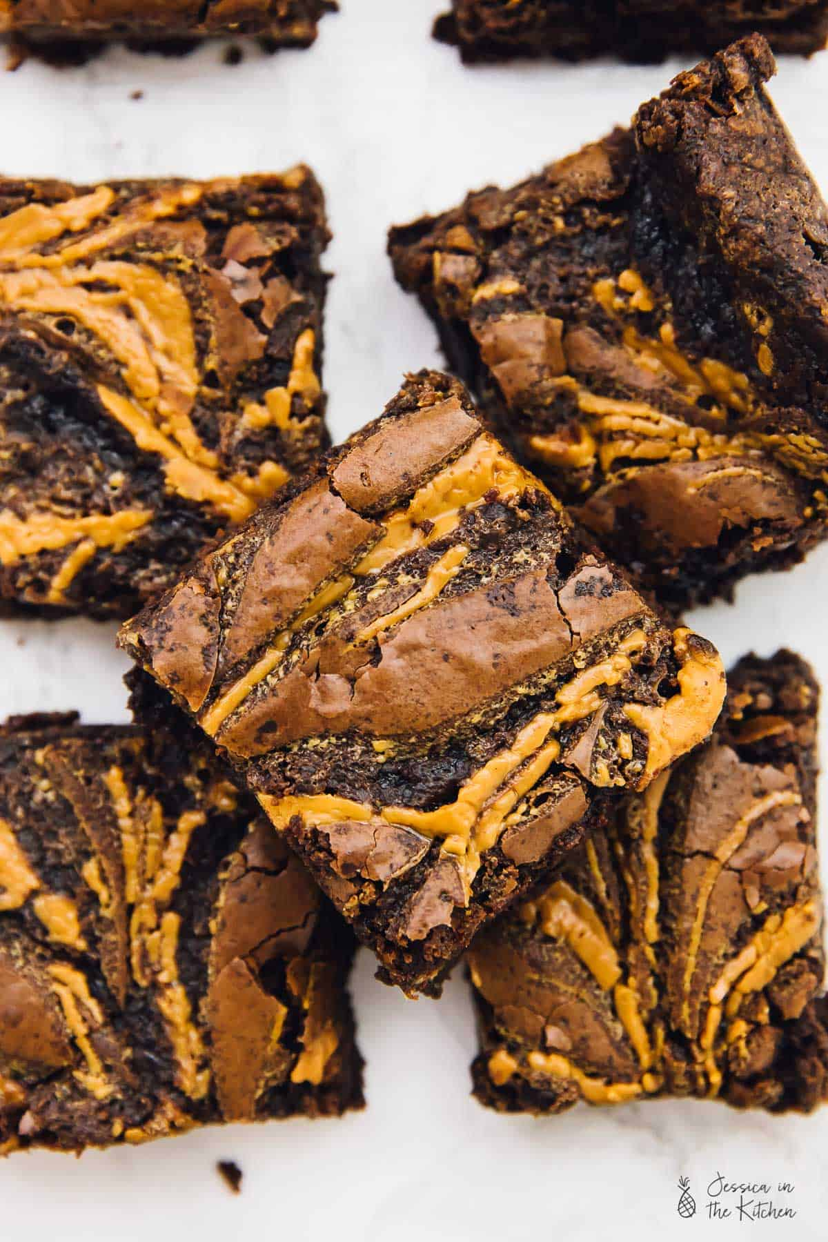 These Vegan Chocolate Peanut Butter Swirl Brownies are beyond addictive! They are chewy, fudgy, rich in chocolate and peanut butter and so easy to make! via https://jessicainthekitchen.com
