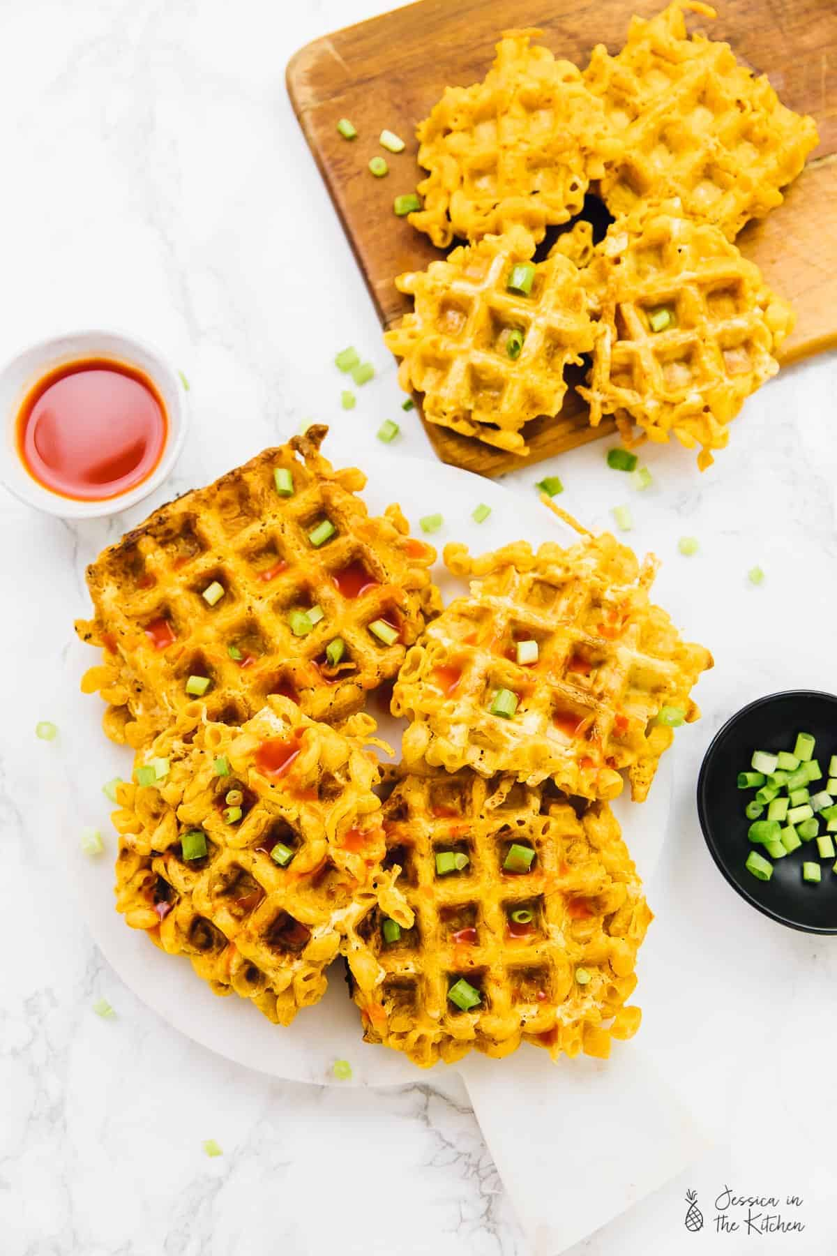 These Crispy Mac and Cheeze Waffles are the perfect indulgent side dish! Two ingredients, and you get crisp on the outside, and soft cheesy Mac and cheese on the inside of these divine waffles! via https://jessicainthekitchen.com