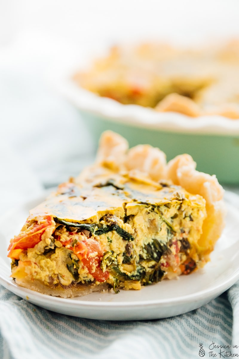 Close up of a slice of vegan quiche on a plate.