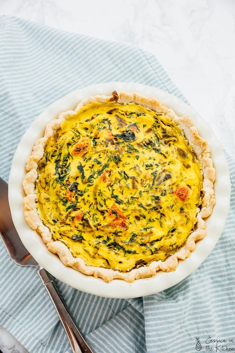 Top down view vegan quiche in a baking dish.
