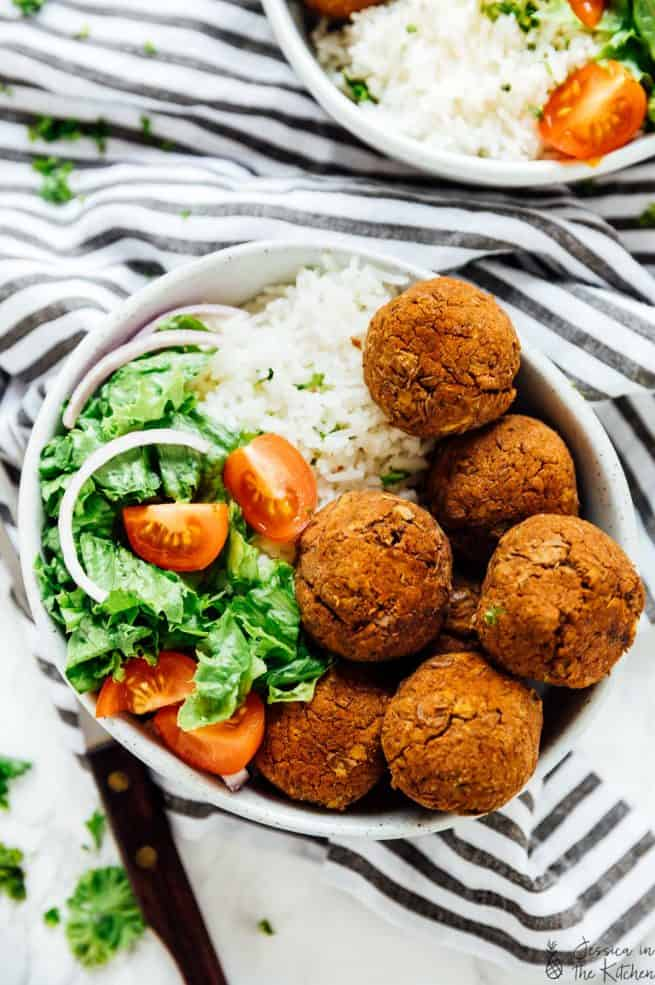 A bowl of lentil balls with salad.