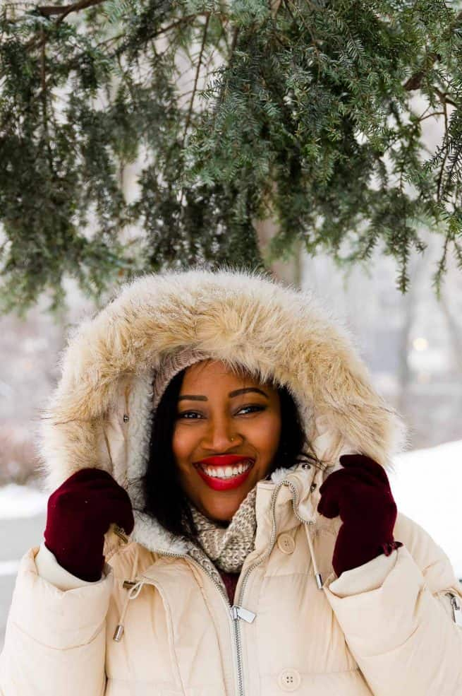 Jessica in the snow, smiling to camera.