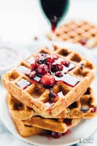 These Orange Cranberry Waffles are bursting with holiday flavour! They drizzled with a Cranberry Maple Compote and are vegan and gluten free! Via https://jessicainthekitchen.com
