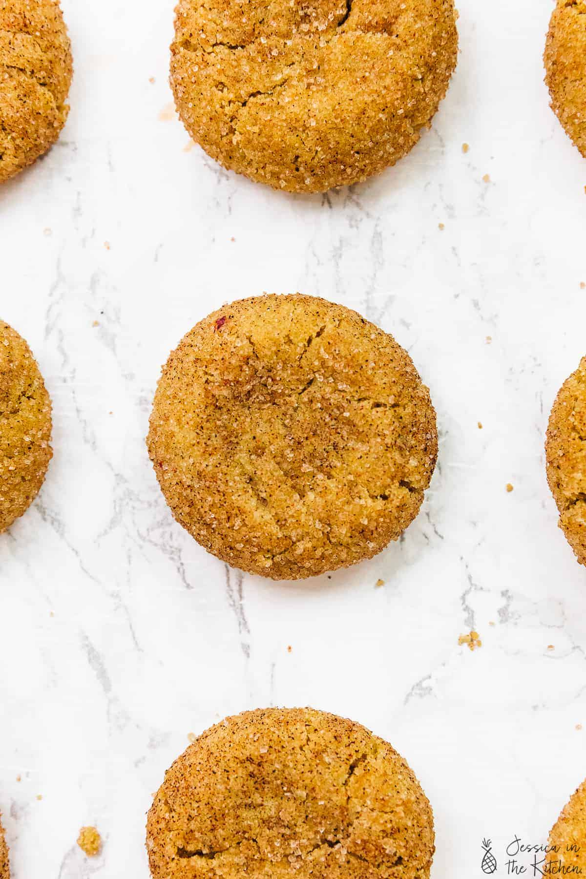 Close up overhead of snickerdoodle cookies with others peeking out at edges.