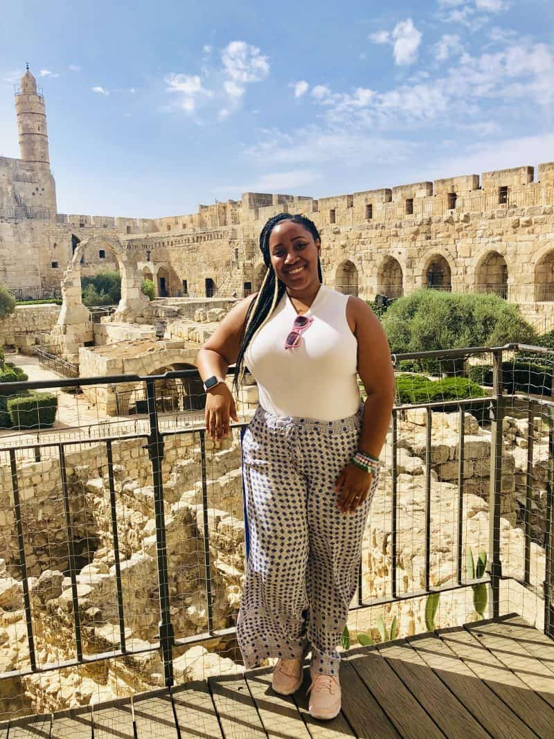 Jessica standing on a courtyard in jerusalem.