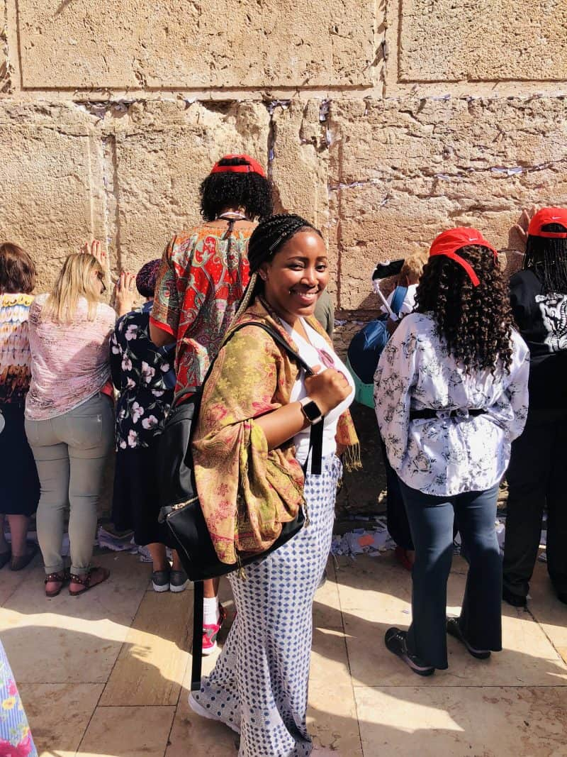Jessica standing in front of the wailing wall.