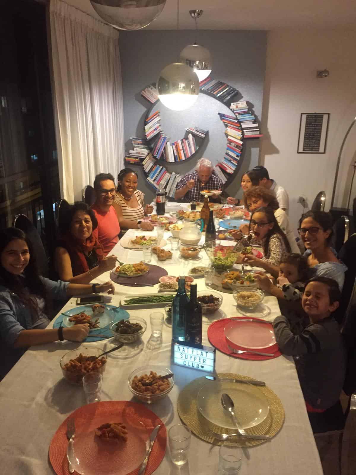 People set around a dinner table.
