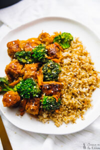 Tempeh stir fry on a white plate.