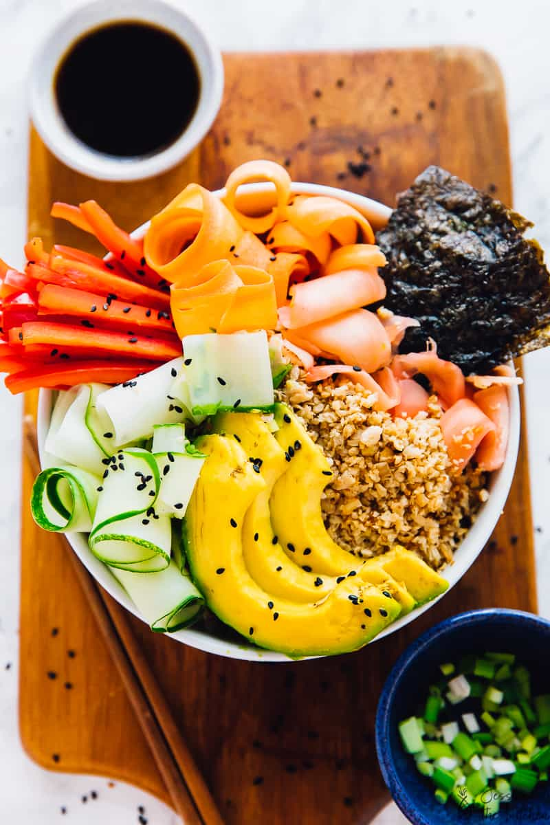 This Vegan Sushi Rice Bowl is quick and easy and like making sushi, in under 30 minutes! It's crunchy, low carb and drizzled with a divine sesame soy dressing! It makes a great quick lunch or dinner! via https://jessicainthekitchen.com