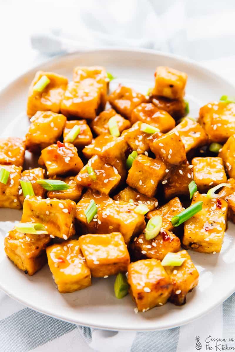 orange air fryer tofu on a plate