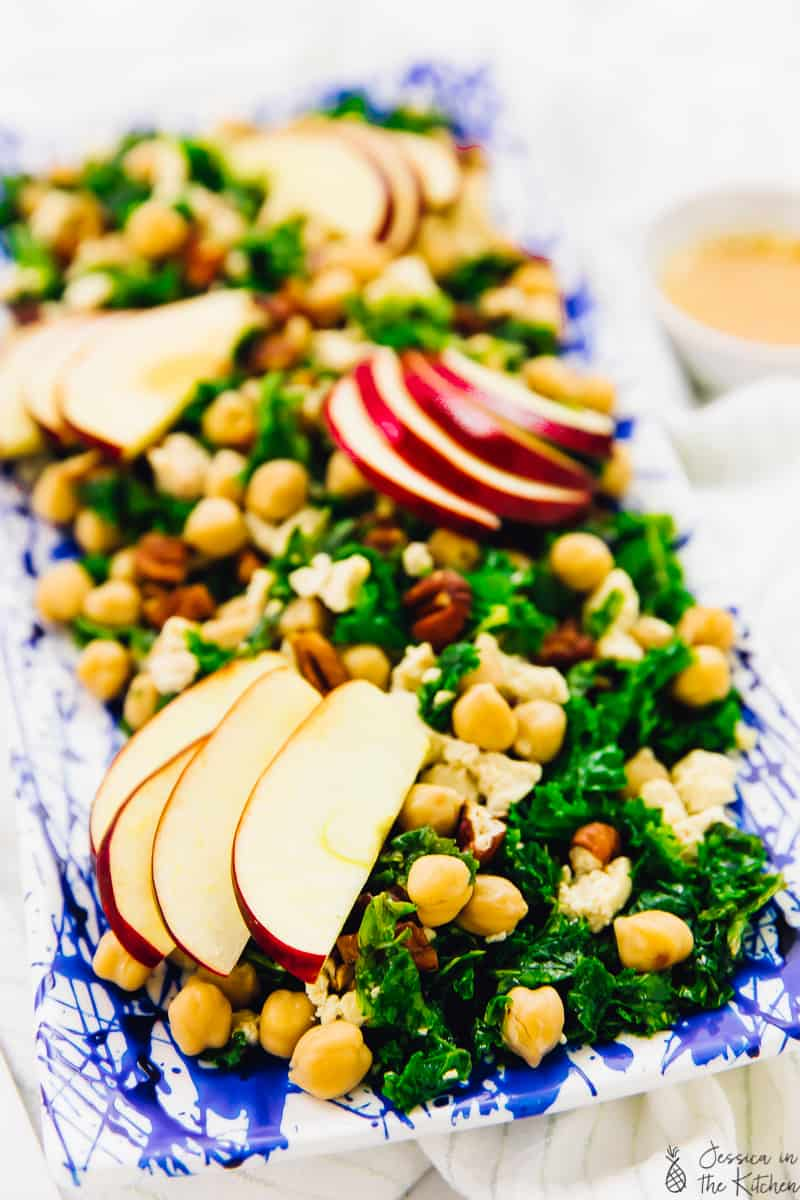 Close up of kale, apple and chickpea salad on a platter.