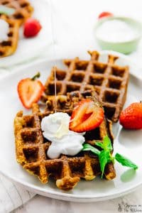 Top down view of low carb waffles on a plate.