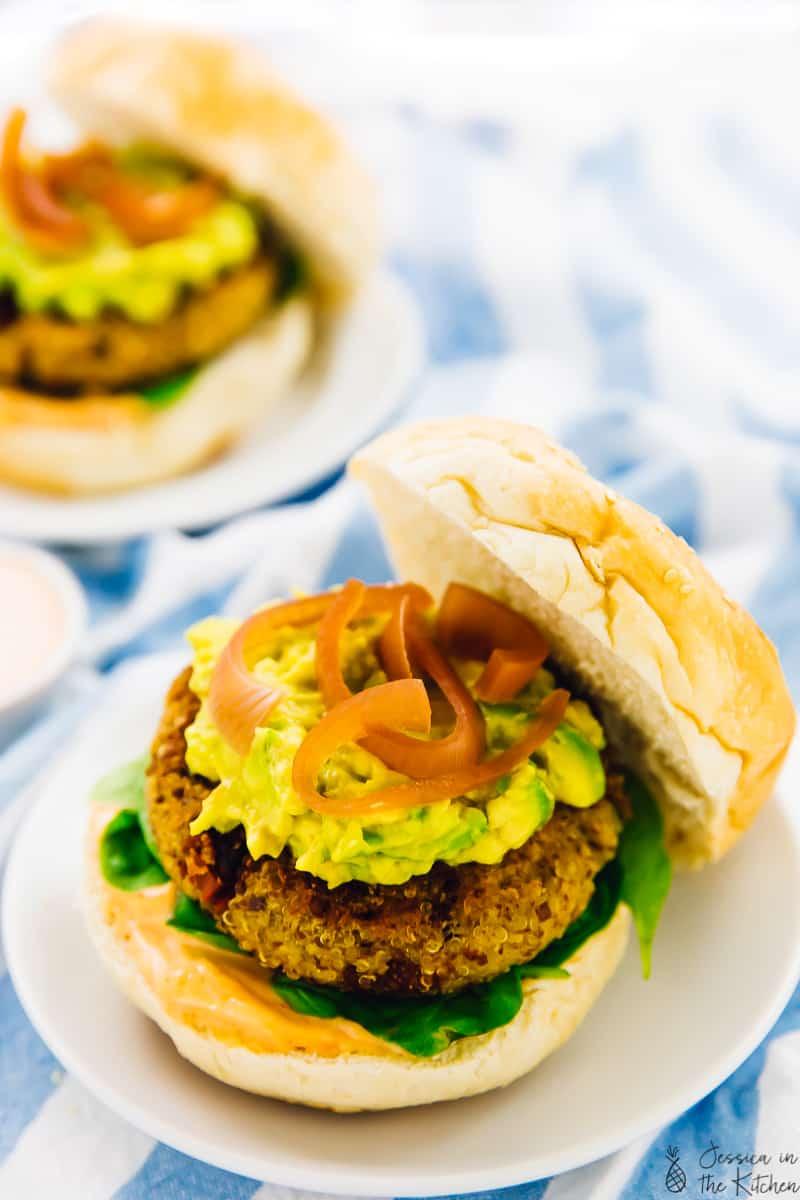 photo of an open faced vegan quinoa veggie burgers on a plate
