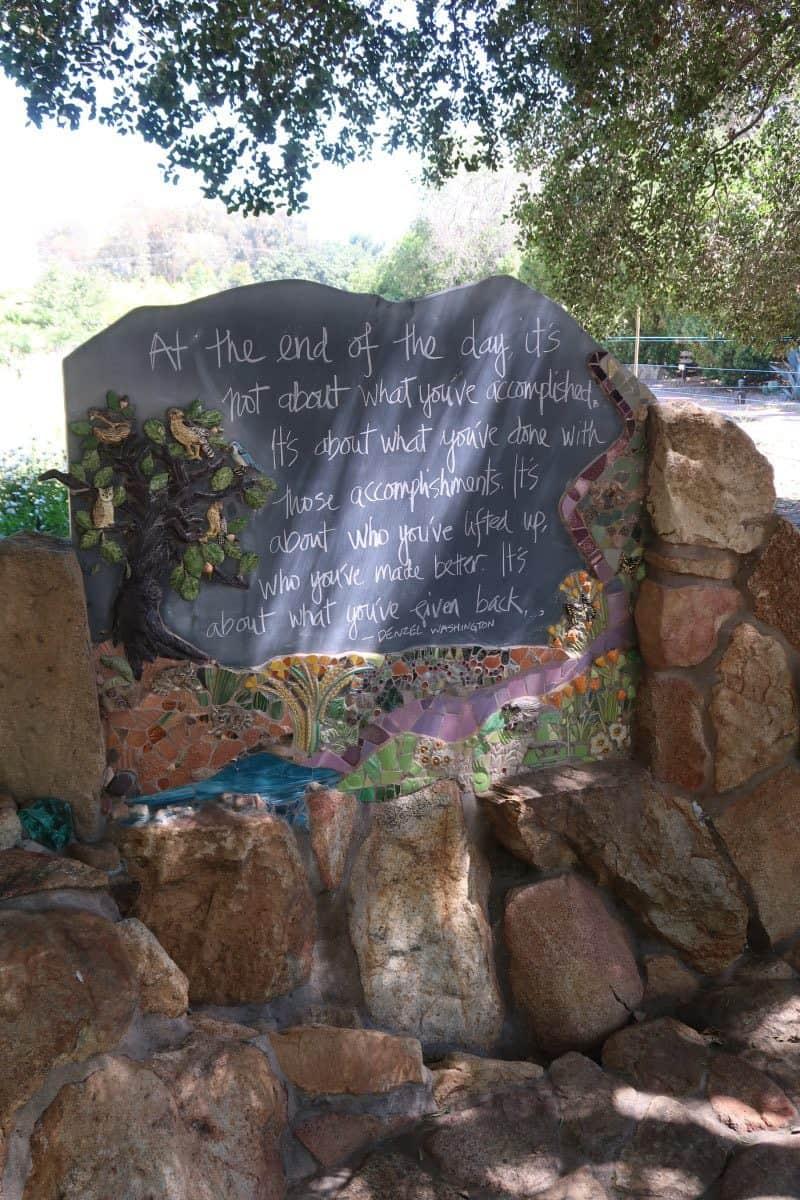 A message written on a rock wall.