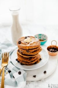 A stack of vegan chocolate chip pancakes on a plate.