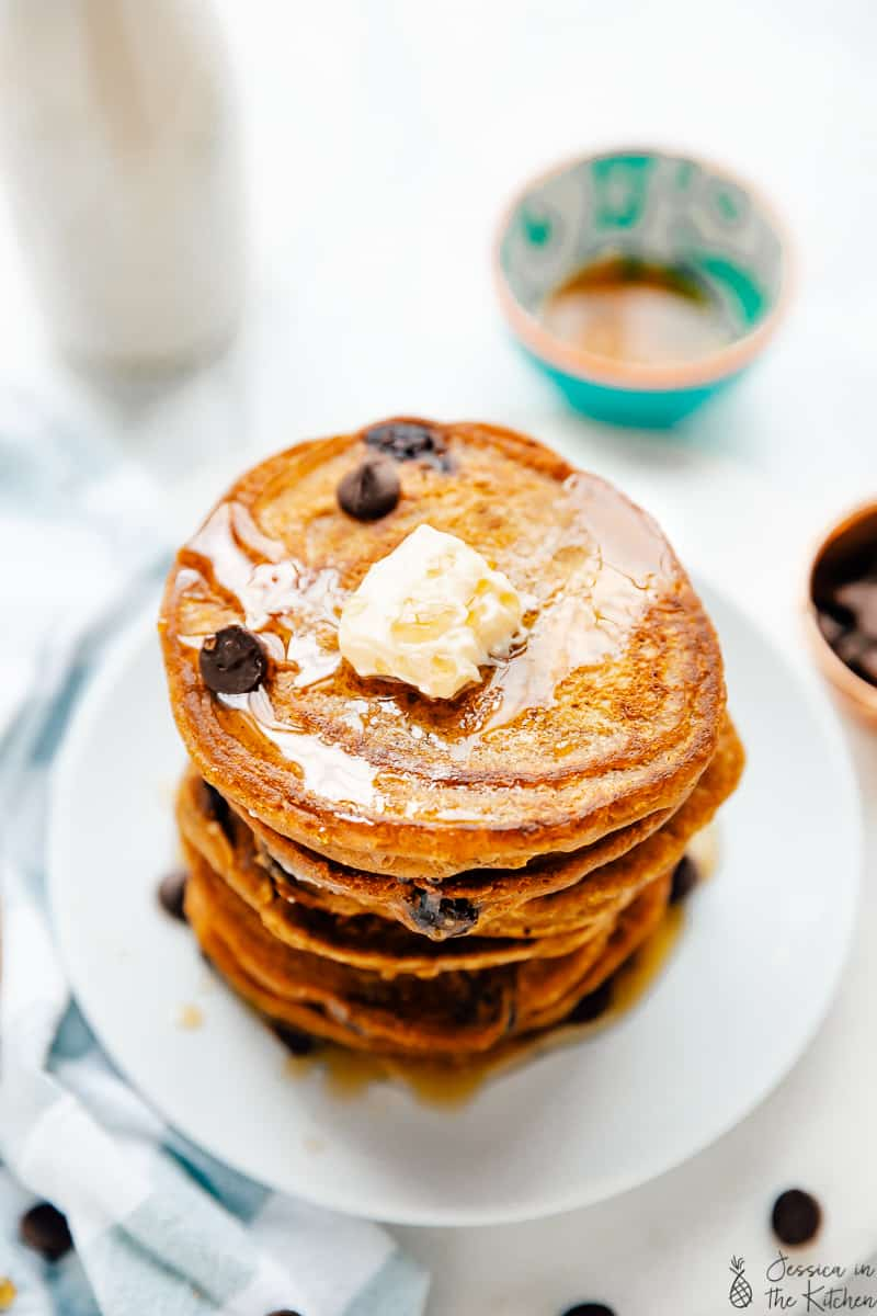 Top down view of a stack of vegan pancakes with chocolate chips.