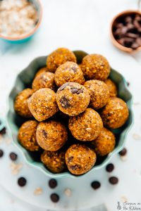 pumpkin energy bites in a bowl in a flatly photo