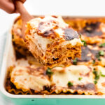 A spatula scooping up a portion of vegan lasagna.
