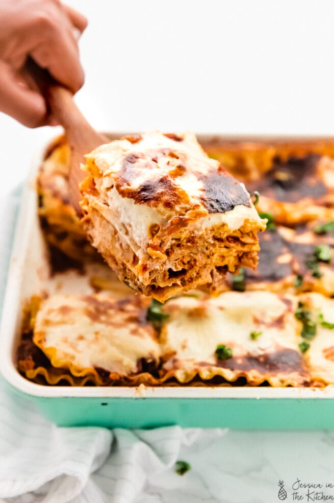 A spatula scooping up a portion of vegan lasagna.