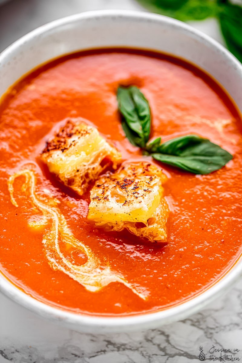 Close up of creamy tomato soup in a bowl.