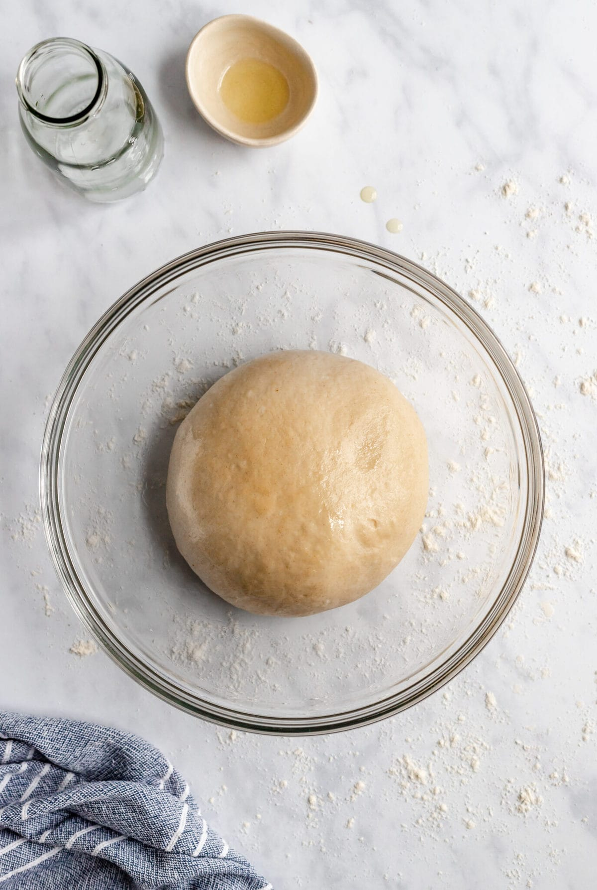 pizza dough in a bowl rising birds eye view