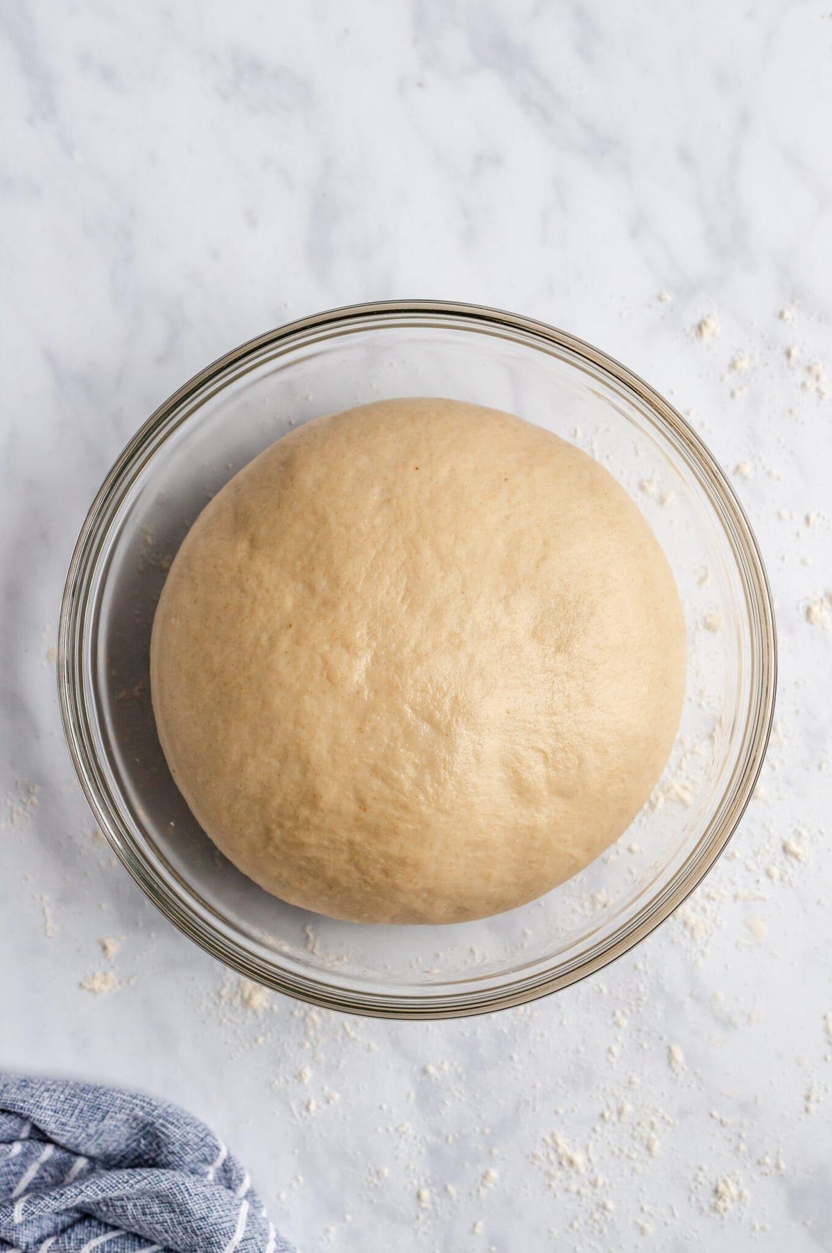 risen dough in a bowl