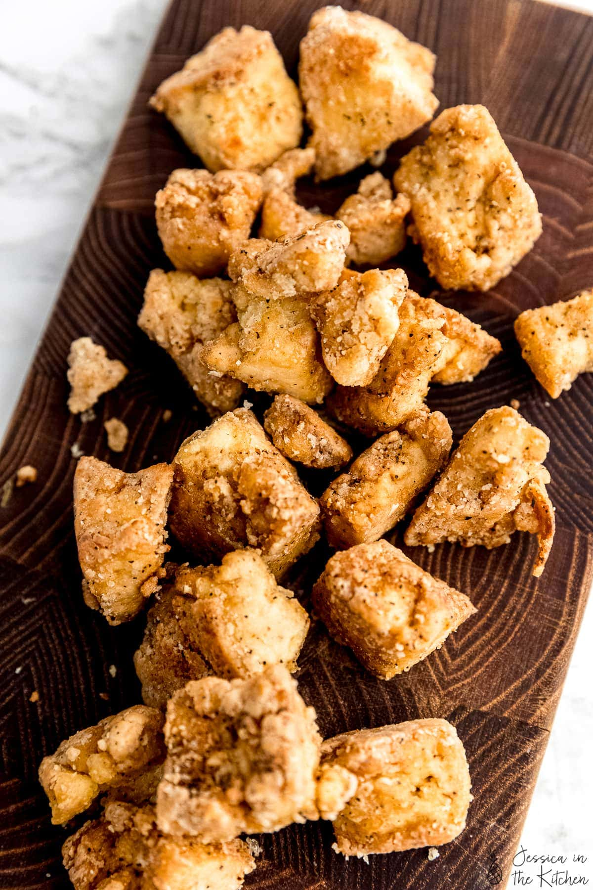 Crispy tofu on a cutting board.