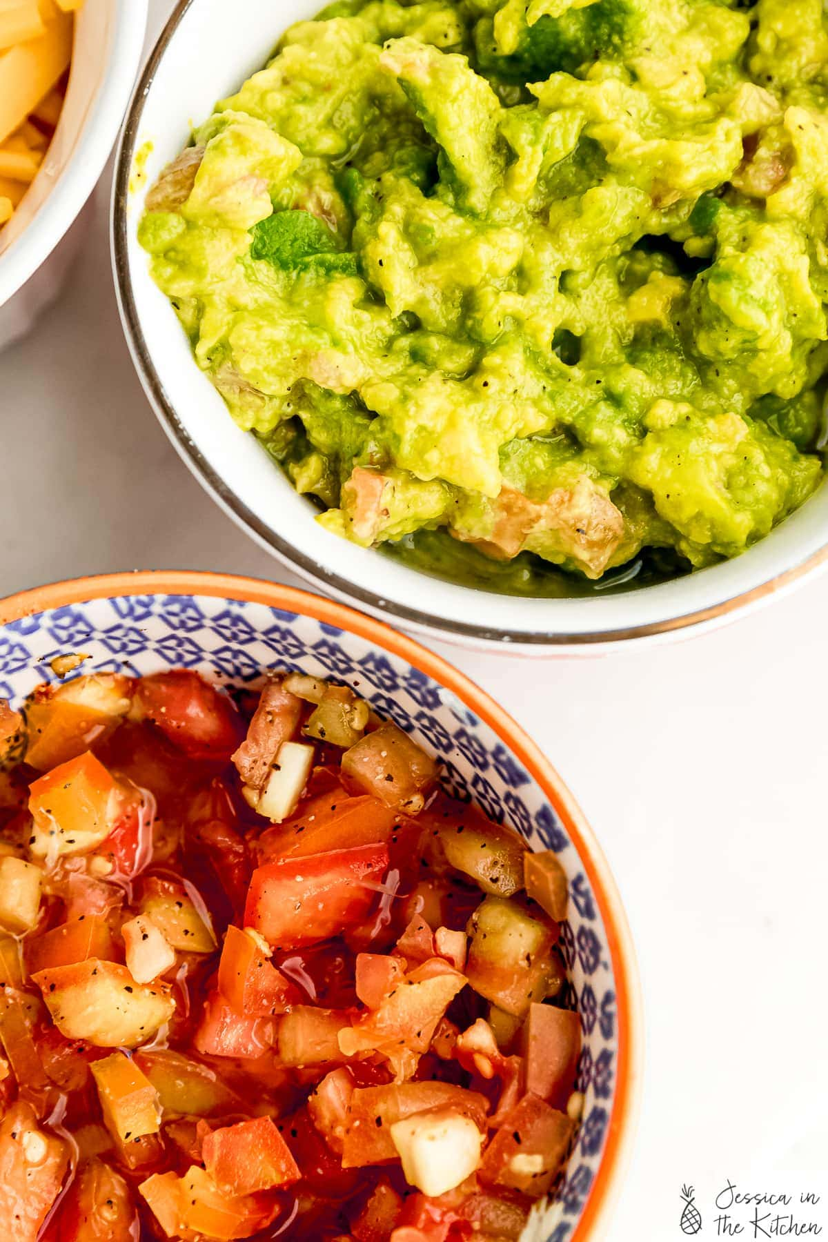 close up of guacamole and salsa