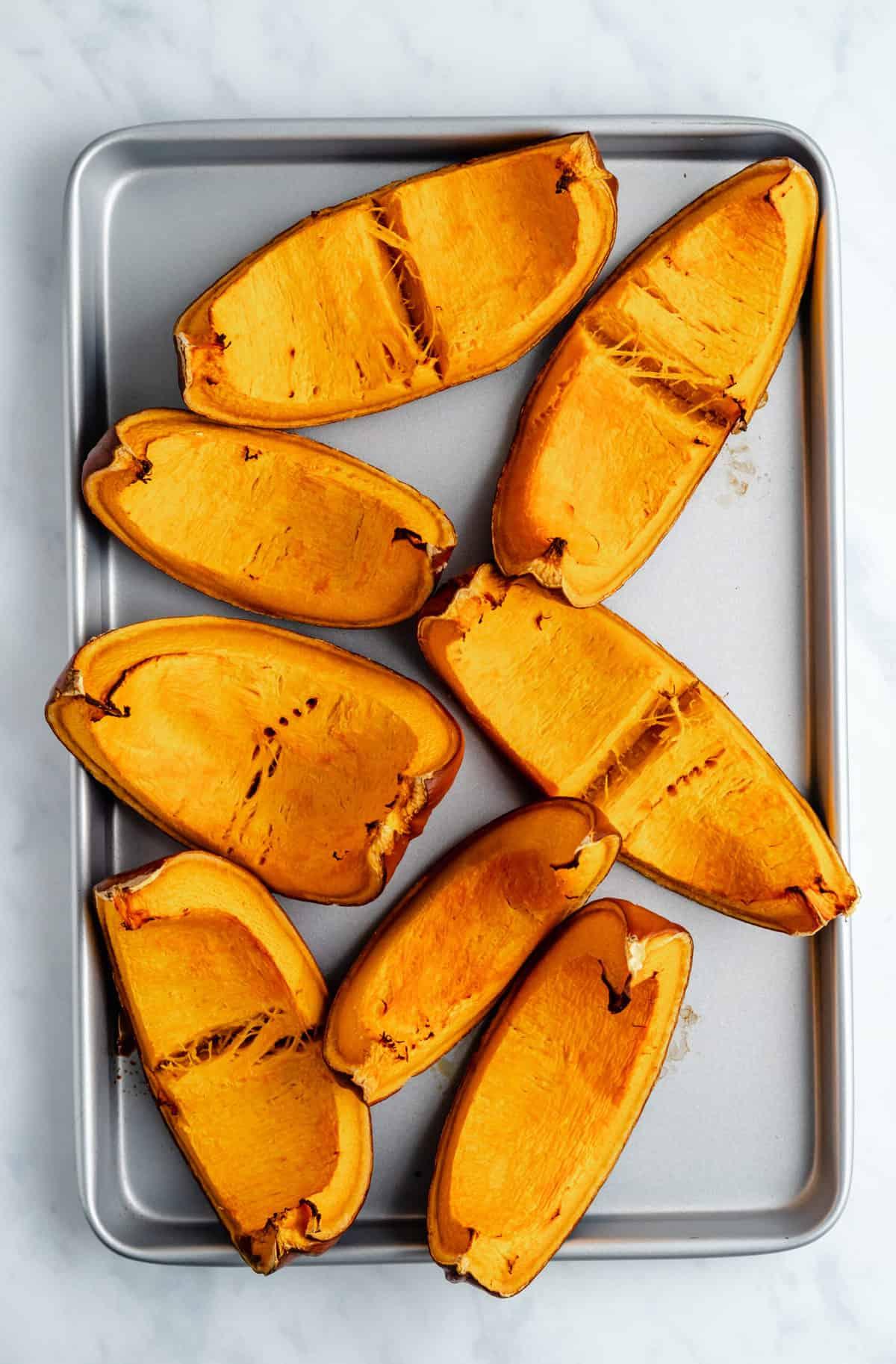 roasted pumpkin on a baking sheet