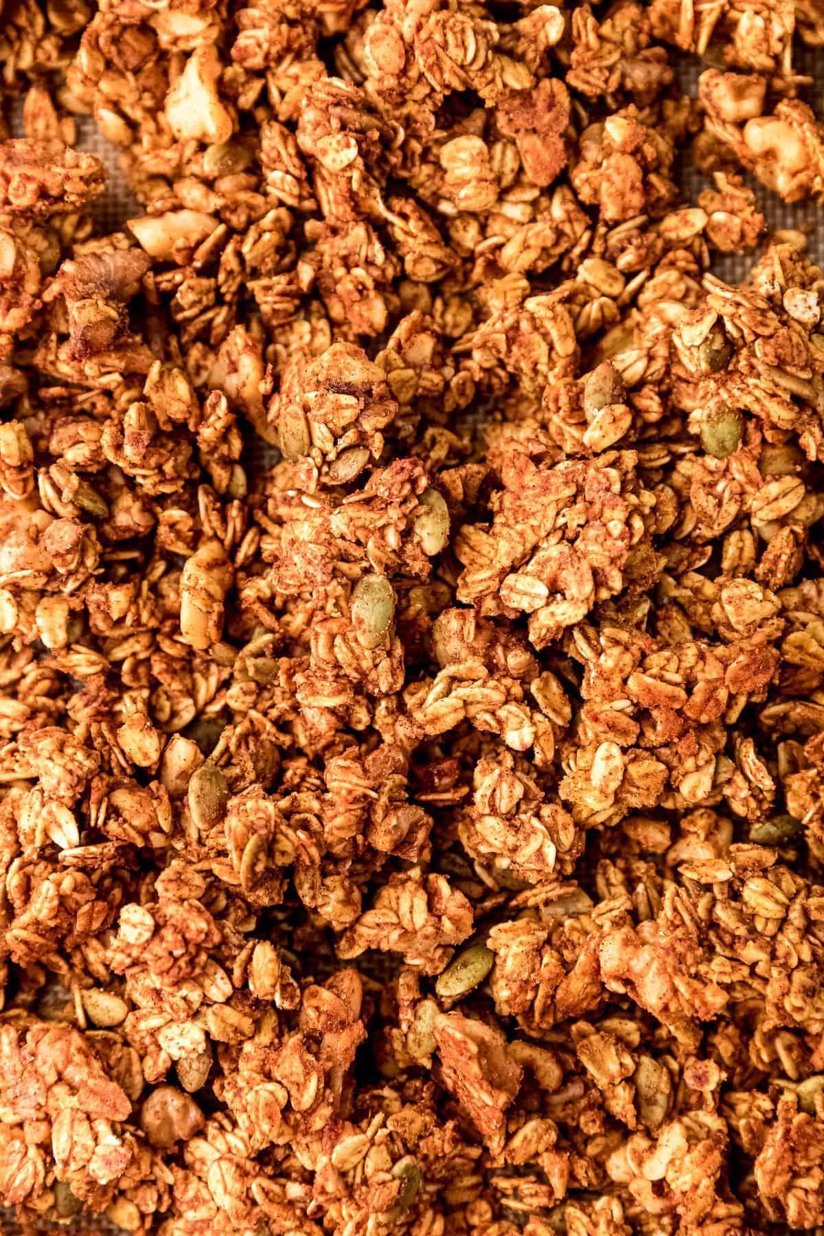 Top down shot of pumpkin granola on baking tray.