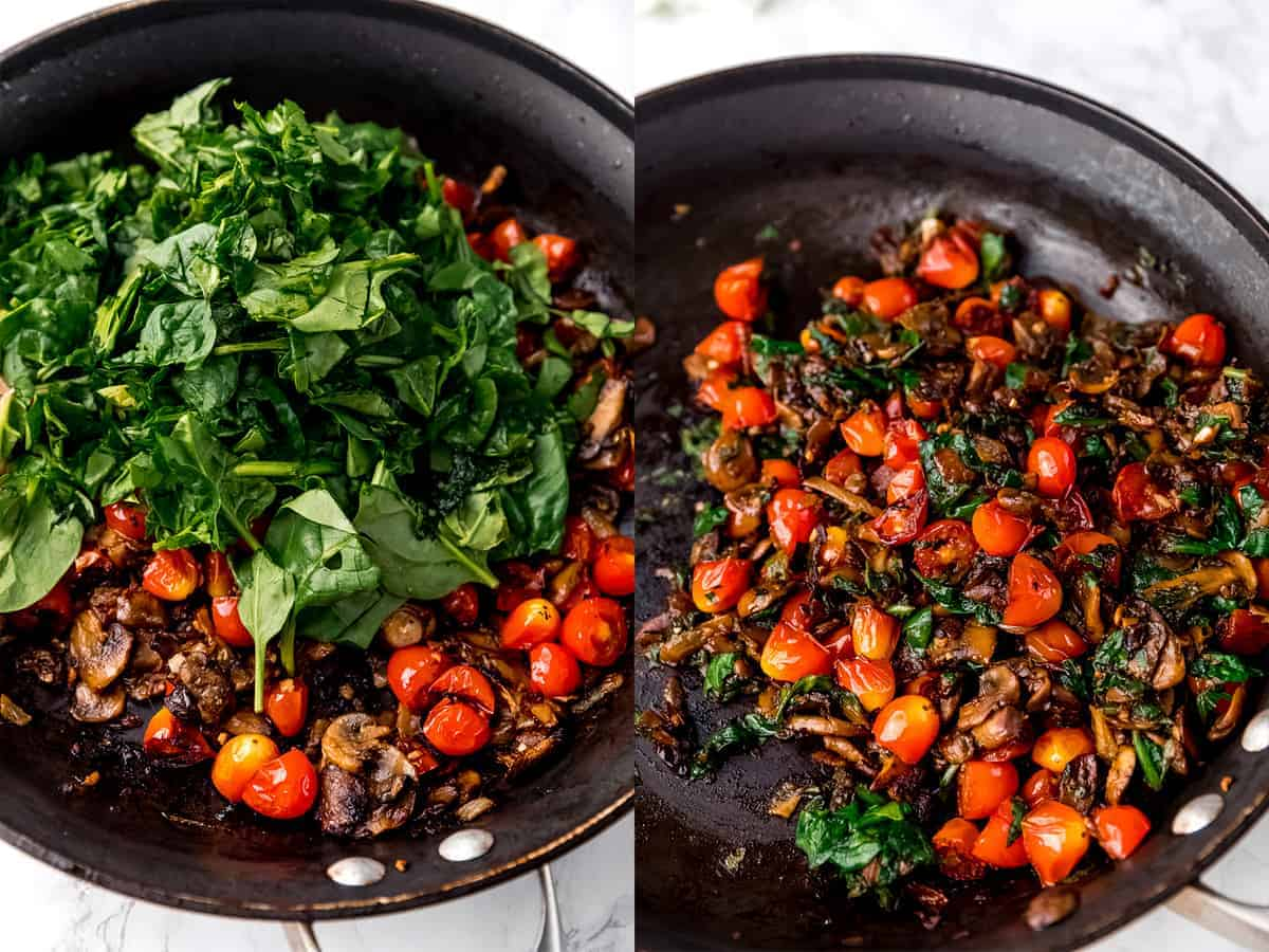 Top down shot of greens cooking in a pan with tomatoes and mushrooms.