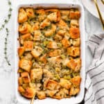 vegan stuffing in a casserole dish with a spoon in it