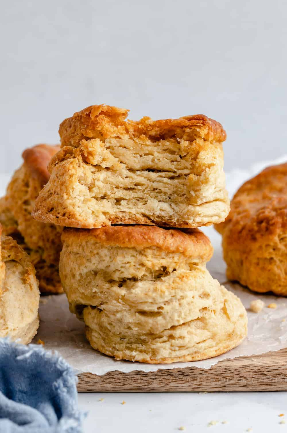 A Stack of Two Fluffy Vegan Biscuits on Top of a Slab of Wood