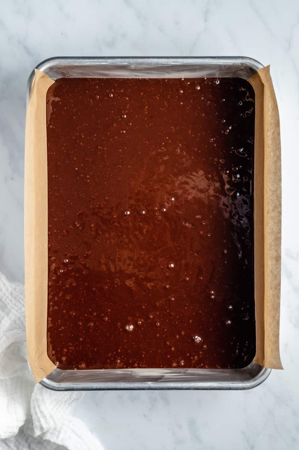 Chocolate cake batter in a sheet pan.