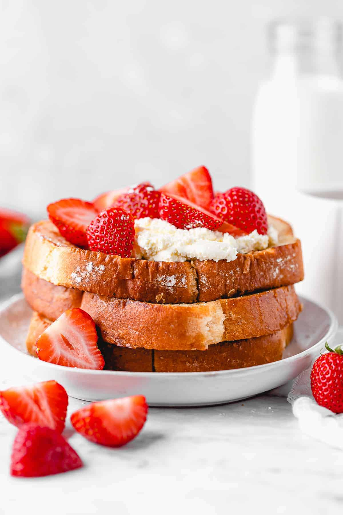 Stacked french toast with strawberries.