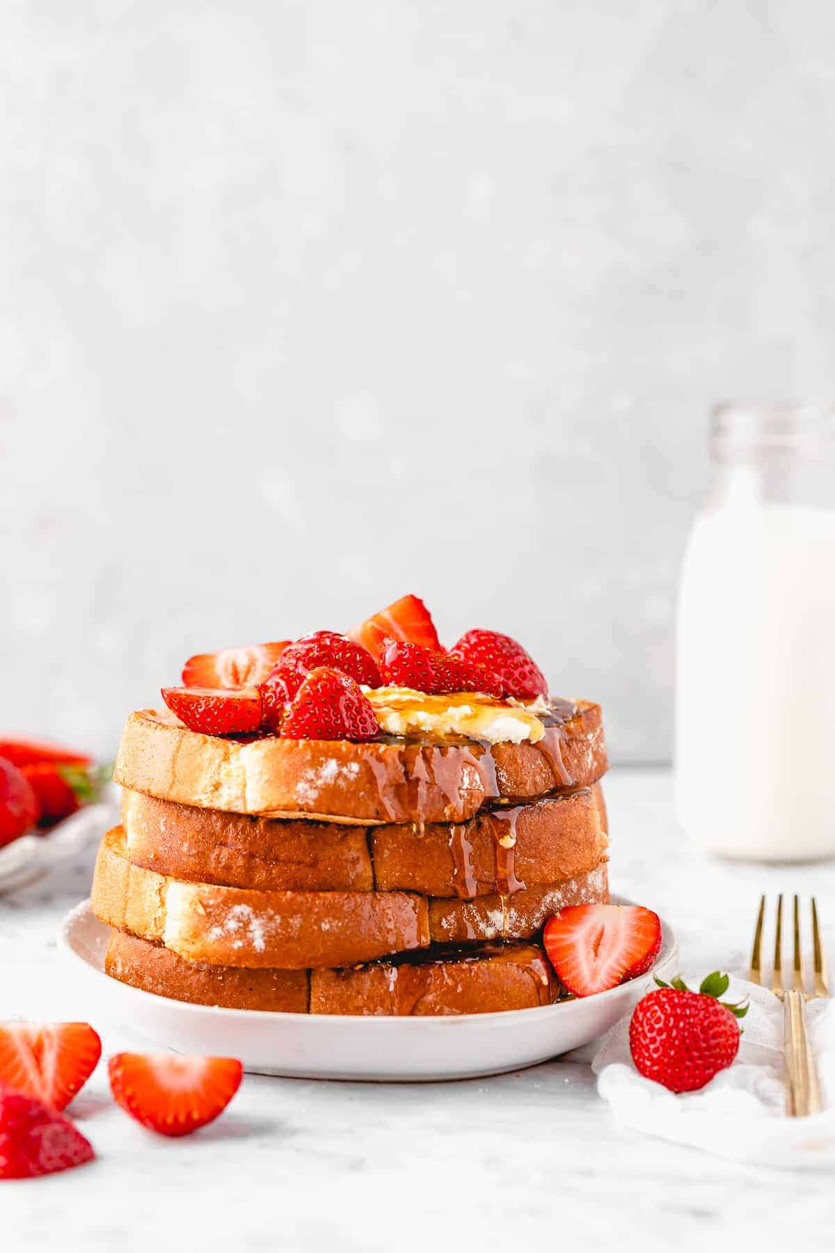 French toast stacked on a plate.