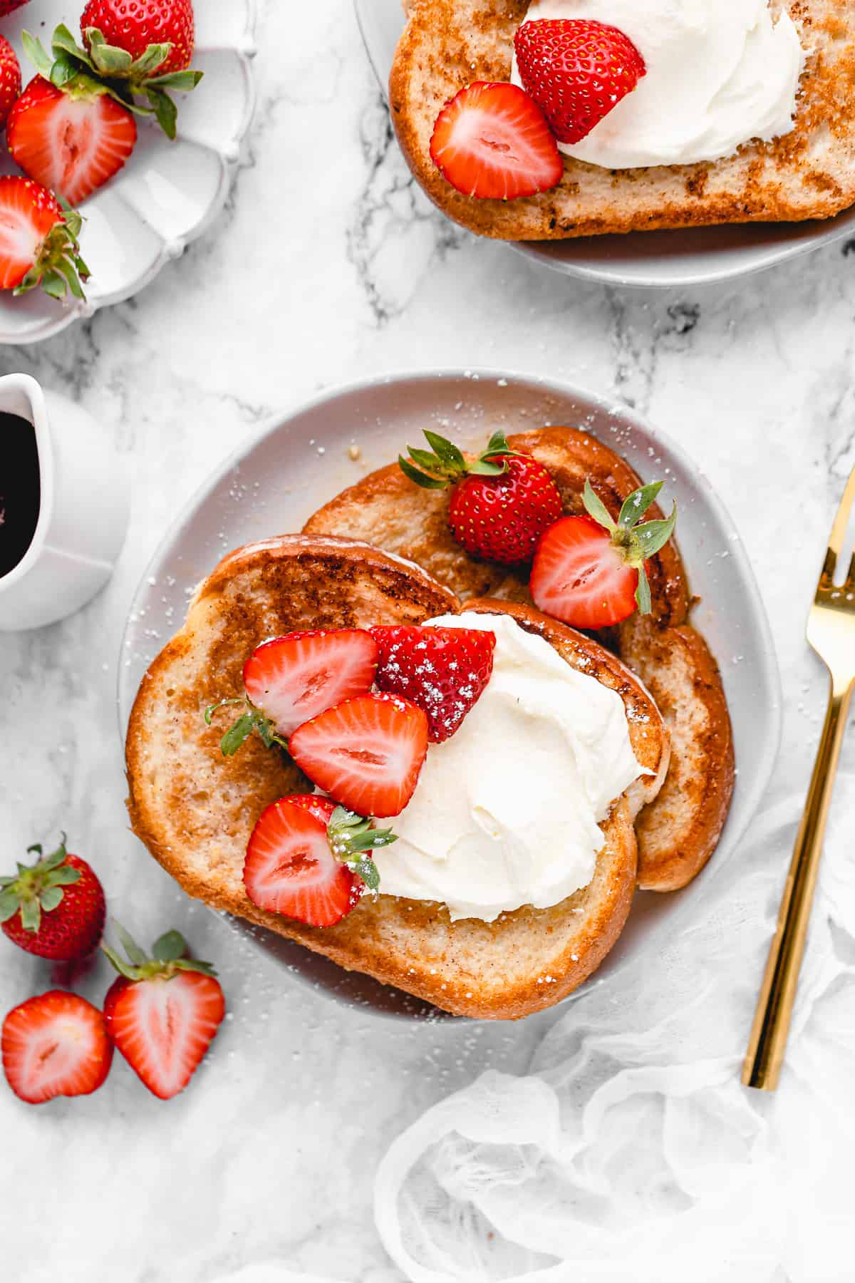 2 slices of french toast with strawberries.