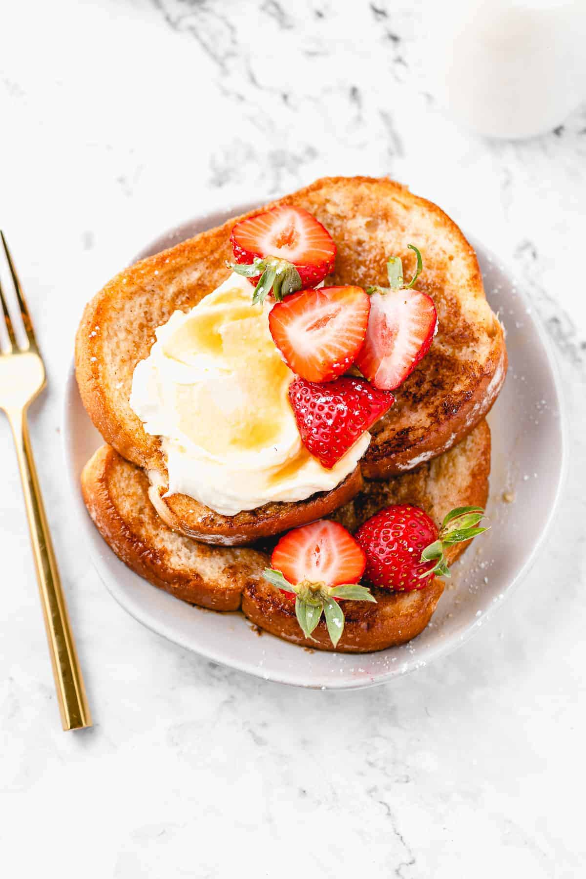 Plate of vegan french toast with strawberries.