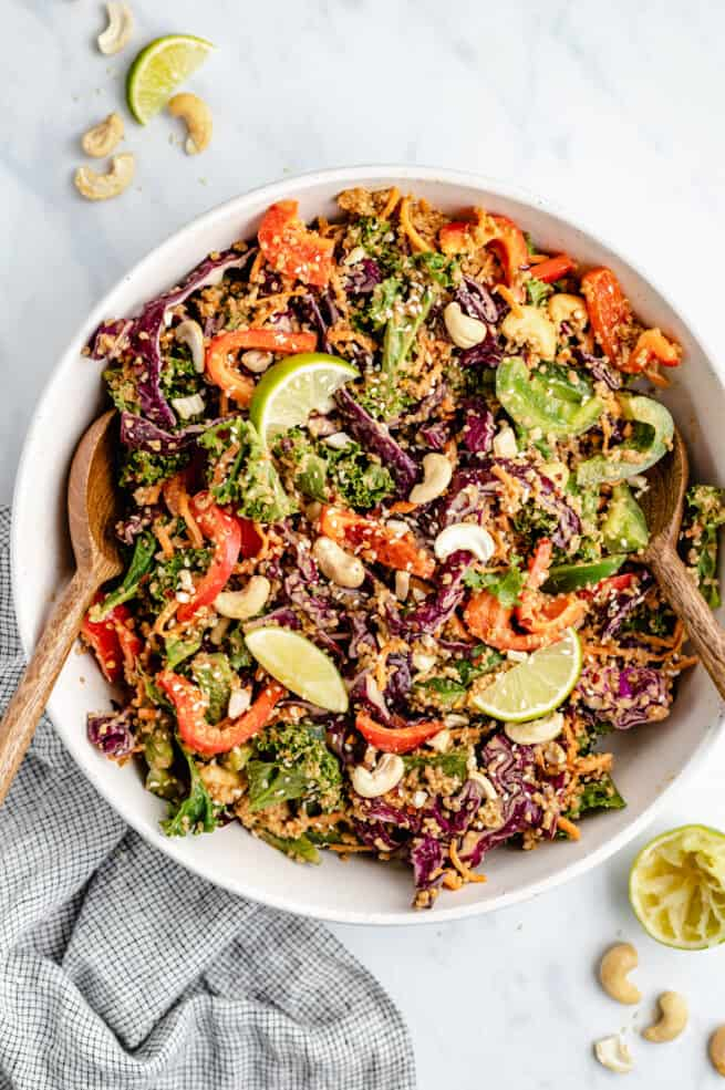 cashew Thai quinoa salad in a bowl with salad servers