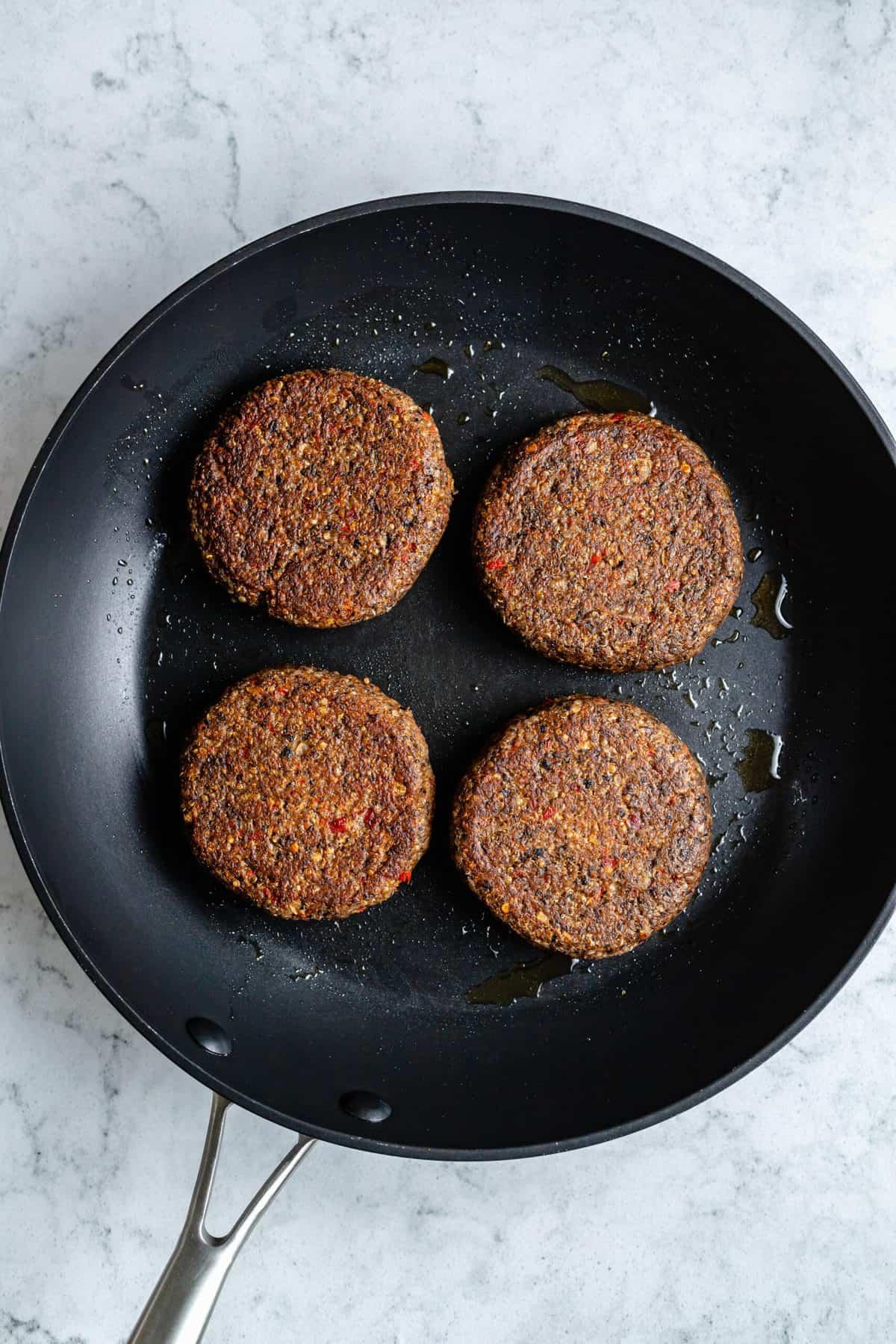 Black bean burgers in a pan.