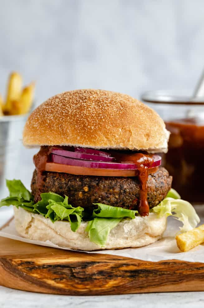 Black bean burger with onion and lettuce.