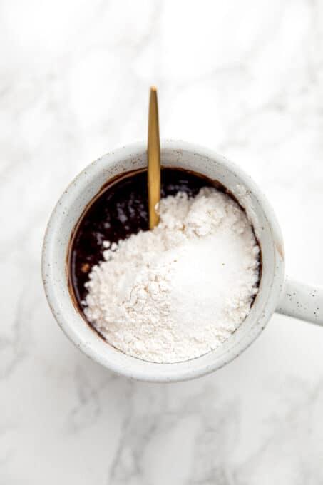 Brownie batter, flour, and salt in a mug.