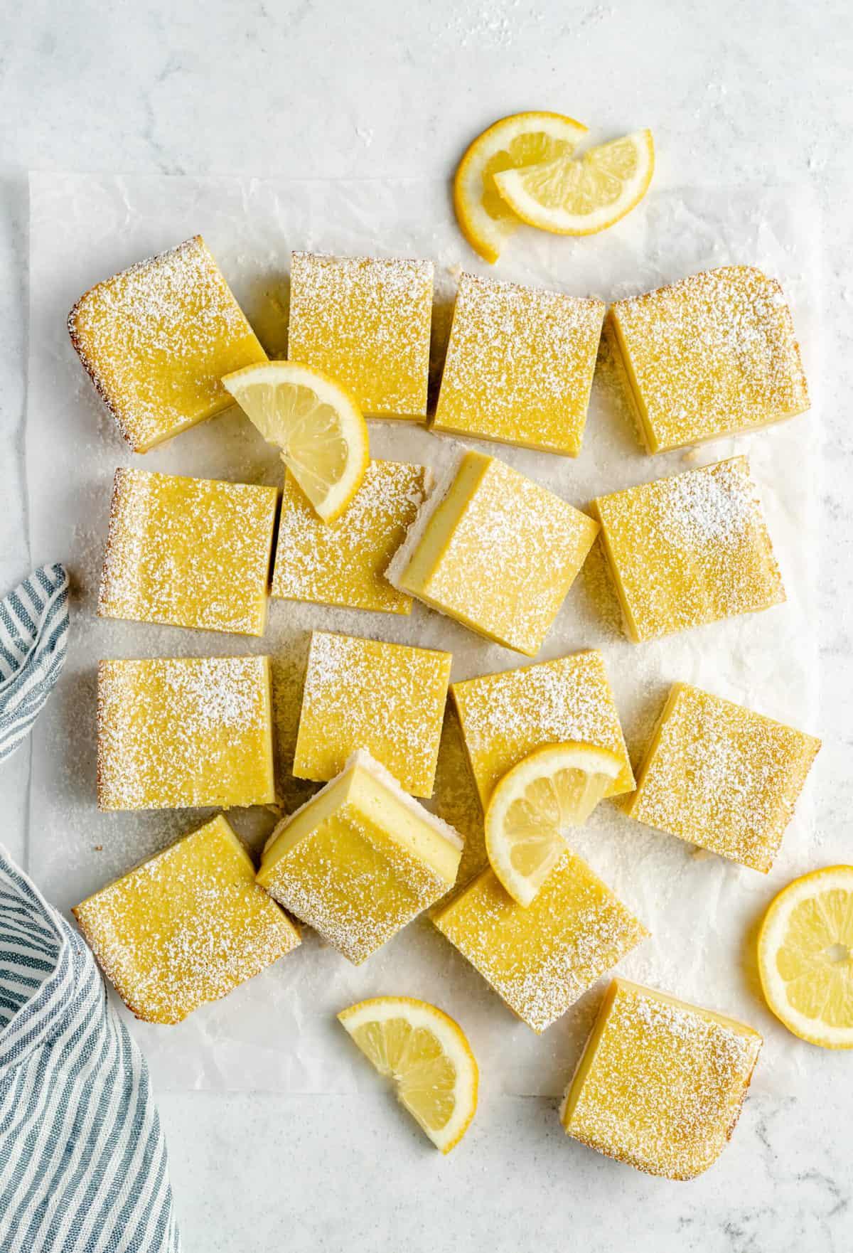 Vegan lemon squares with powdered sugar.