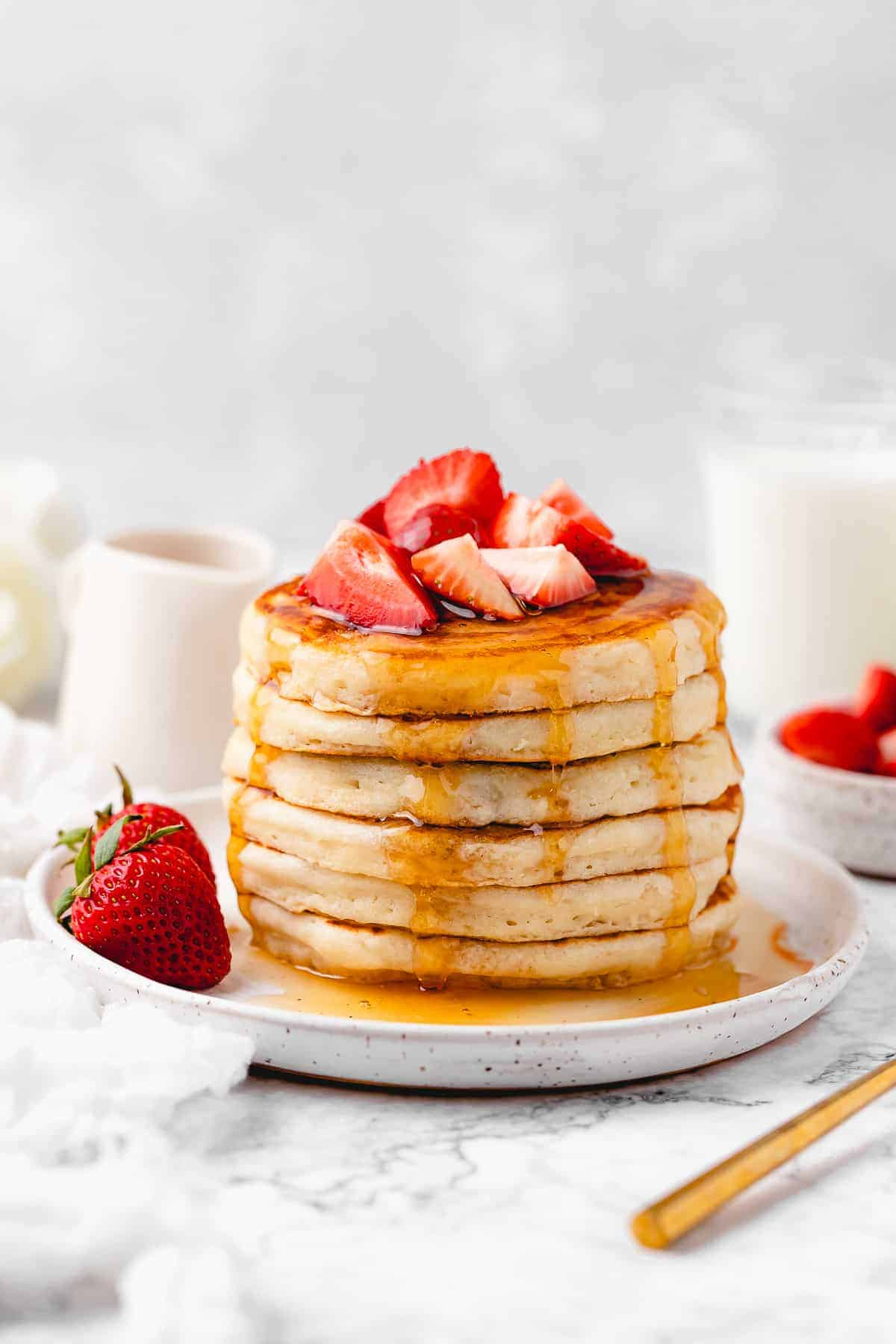 Vegan pancakes and chopped strawberries.
