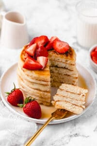 Sliced pancake stack with strawberries.